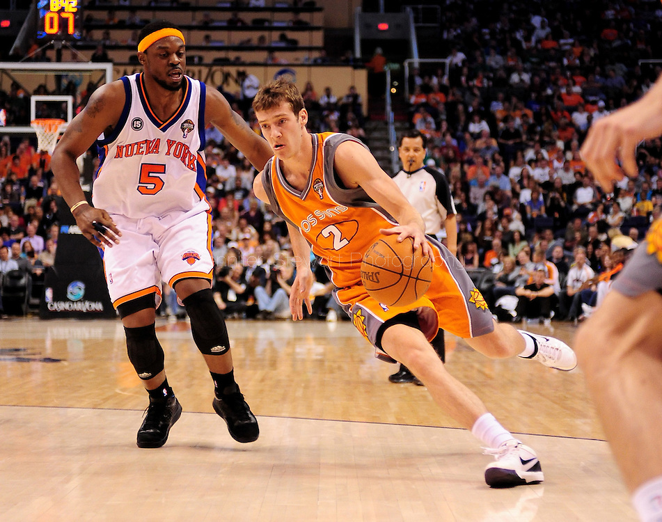 Mar. 26 2010; Phoenix, AZ, USA; Phoenix Suns guard Goran Dragic (2) drives the ball against New York Knicks guard Bill Walker (5) in the second half at the US Airways Center.  The Suns defeated the Knicks 132-96.  Mandatory Credit: Jennifer Stewart-US PRESSWIRE.
