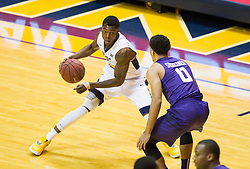Feb 13, 2016; Morgantown, WV, USA; West Virginia Mountaineers guard Teyvon Myers (0) attempts to get past TCU Horned Frogs guard Lyrik Shreiner (0) during the first half at the WVU Coliseum. Mandatory Credit: Ben Queen-USA TODAY Sports