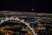 Super moon rising over an aerial view of Las Vegas city at night, Nevada, USA