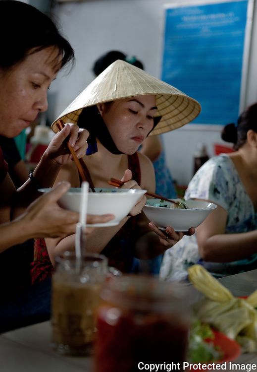 diners at a ho chi minh city noodle shop, vietnam