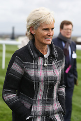 © Licensed to London News Pictures. 08/04/2016. Liverpool, UK. Judy Murray, mother of tennis player Andy Murray, walks the course on Ladies Day at the Grand National 2016 at Aintree Racecourse near Liverpool. The race, which was first run in 1839, is the most valuable jump race in Europe. Photo credit : Ian Hinchliffe/LNP