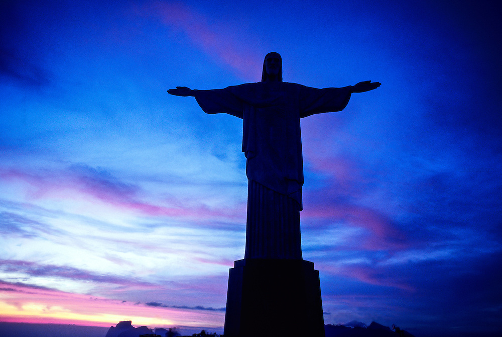 View of Statue of Christ the Redeemer (Cristo Redentor) at sunset, Corcovado Mountain, Rio de Janeiro, Brazil