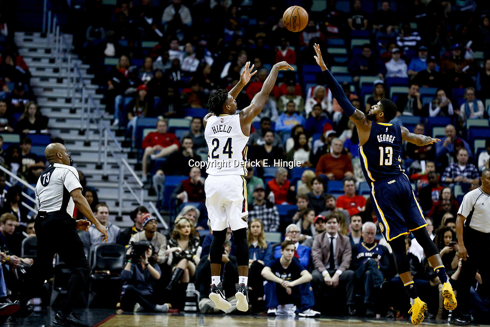 Dec 15, 2016; New Orleans, LA, USA; New Orleans Pelicans guard Buddy Hield (24) shoots over Indiana Pacers forward Paul George (13) during the first quarter of a game at the Smoothie King Center. Mandatory Credit: Derick E. Hingle-USA TODAY Sports