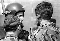 The Silver Jubilee visit of Queen Elizabeth II to N Ireland on 10th & 11th August 1977 sparked serious rioting in Belfast as those opposed to the visit tried to reach the city centre.  Here an injured soldier is comforted by colleagues. 197708100074c<br />