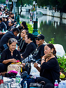 24 OCTOBER 2017 - BANGKOK, THAILAND: People on Atsadang Road wait to enter the royal cremation site. People started camping out along Atsadang Road in Bangkok near the royal cremation site on Monday. The gates won't open until Wednesday morning and the cremation isn't until Thursday night, so most people will sleep outside, on sidewalks and footpaths for three nights. Hundreds of thousands of people are expected to try to get into Sanam Luang, the site of the cremation of Bhumibol Adulyadej, the Late King of Thailand, but the site will only hold about 60,000 people. The Thai government has built replica crematoriums around Bangkok to accommodate the overflow crowds.        PHOTO BY JACK KURTZ