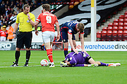 Thorsten Stuckmann is injured in the challenge from Tom Bradshaw during the Sky Bet League 1 match between Walsall and Doncaster Rovers at the Banks's Stadium, Walsall, England on 12 September 2015. Photo by Alan Franklin.