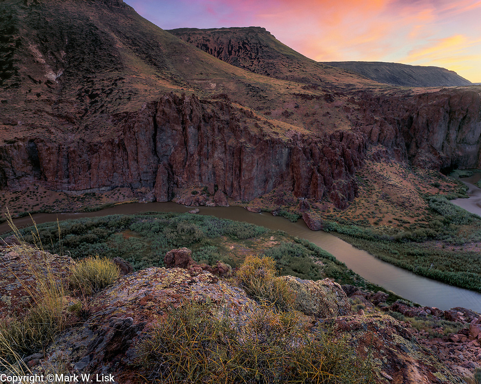 The Bruneau River winds slowly through basalt and ryolite cliffs in the Owyhee Desert of southwest Idaho.