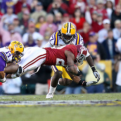 November 6, 2010; Baton Rouge, LA, USA;  LSU Tigers cornerback Tyrann Mathieu (14) and safety Karnell Hatcher (37) tackle Alabama Crimson Tide running back Mark Ingram (22) during the second half at Tiger Stadium. LSU defeated Alabama 24-21.  Mandatory Credit: Derick E. Hingle