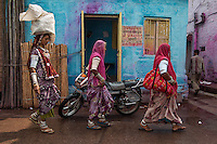 Jodhpur, India: Women in traditional dress walk in the old city on the fringes of the desert in Rajasthan.