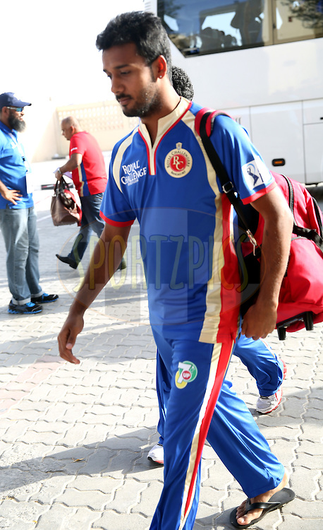 Abu Nechim Ahmed of the Royal Challengers Bangalore walks in before the match 2 of the Pepsi Indian Premier League Season 7 between the Delhi Daredevils and The Royal Challengers Bangalore held at the Sharjah Cricket Stadium, Sharjah, United Arab Emirates on the 17th April 2014<br /> <br /> Photo by Sandeep Shetty / IPL / SPORTZPICS