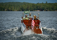 "Dick and Patricia Hopgood take a cruise in their 1910 Goodhue and Hawkins 36' Laker ""Keen Kutter""  around Cow Island on Lake Winnipesaukee, New Hampshire.  ©2018 Karen Bobotas Photographer"