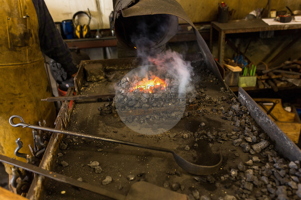 A blacksmith forge and metal working tools at a iron working shop in Charleston, SC
