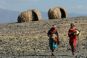 El-Moro Tribe, Loyangalani Village, Lake Turkana, Northern Kenya, Southern East Africa...Women from the Traditional El-Molo tribe walk down to the waters edge of Lake Turkana also known as the vast and and yet totally barren, Jade Sea in Northern Kenya...© Demelza Cloke.DVD0001.....
