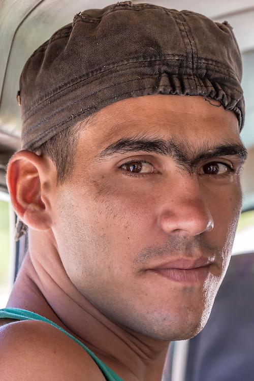 Man with big eyebrows in Charco Redondo, Granma, Cuba.