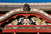 Photo shows a detail of the colorfully decorative exterior of the main Seiden hall inside the grounds of Shuri-jo Castle in Naha, Okinawa Prefecture, Japan, on June 24, 2012. Seiden functioned as the central structure of the Ryukyu kingdom for over 500 years and was restored in 1992. Photographer: Robert Gilhooly