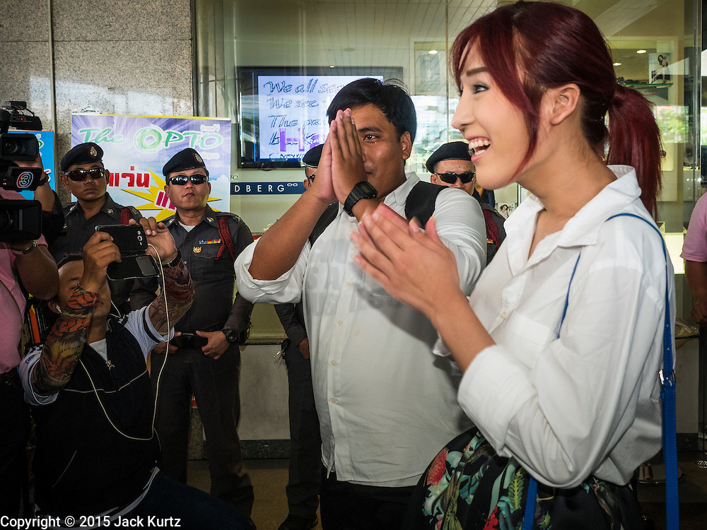22 MAY 2015 - BANGKOK, THAILAND:  Anti-coup activists SIRIWAT SERITHIWAT (left) and NATCHACAH KONG-UDOM arrive in Lat Phrao subway stop to start an anti-coup protest.  The Thai military seized power in a coup on May 22, 2014. There were small protests throughout Bangkok Friday to mark the first anniversary of the coup. Police arrested protestors at several locations. The most serious protest was at Bangkok Art and Culture Centre (BACC) where about 100 protestors, mostly students, faced off against police for several hours. Police made numerous arrests at the BACC protest.    PHOTO BY JACK KURTZ