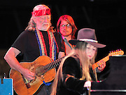 Legendary musician Willie Nelson plays The Pallidiium in Dallas Texas as part of an ASPCA fundraiser for Super Bowl Weekend. The show was special Willie messed up the words to his own songs and could not keep up with the band. Willie's son backed him up on guitar and his sister played piano. Photo©SuziAltman