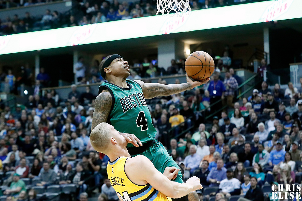 10 March 2017: Boston Celtics guard Isaiah Thomas (4) goes for the layup past Denver Nuggets center Mason Plumlee (24) during the Denver Nuggets 119-99 victory over the Boston Celtics, at the Pepsi Center, Denver, Colorado, USA.