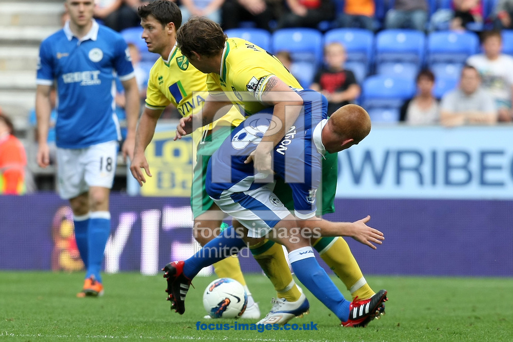Grant Holt of Norwich and Ben Watson of Wigan Athletic in action during the Barclays Premier League match at the DW Stadium, Wigan...Picture by Paul Chesterton/Focus Images Ltd. .07904 640267.13/8/11