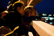 Lathan Goumas for the Midland Daily News..Neal Gleason, 4, of Lapeer, watches the final display of fireworks with his mother Angelina Palmer, also of Lapeer, at the 50th Bay City Fireworks Festival in Bay City, Mich. on Saturday, July 7, 2012. In celebration the festival planned to fire off 50,000 fireworks in 50 minutes on the final day of the three day event.