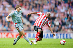 SUNDERLAND, ENGLAND - Saturday, August 16, 2008: Liverpool's captain Steven Gerrard MBE and Sunderland's El-Hadji Diouf during the opening Premiership match of the season at the Stadium of Light. (Photo by David Rawcliffe/Propaganda)