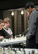 Middletown, NY - Chess champion Deepak Aaron ponders a move while playing 32 opponents simultaneously in an exhibition at Middletown High School on Saturday, Jan. 30, 2010. Aaron recently won the North American Youth Chess Championship in the Under-16 category. He is a master candidate.