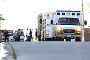 "Ambulances sit on standby on S. Meadowlark Ave.as Springfield's Hazardous Material (HAZMAT) team enters a home where a suspicious white powder was found in an envelope in a Southwest Missouri woman's mail on May 22, 2012 in Springfield, Missouri. After four hours, the team declared ""all clear"" for the area and determined there was no threat to the public. (David Welker / TurfImages.com).."