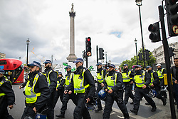 "© Licensed to London News Pictures . 24/06/2017. London, UK. Police on Trafalgar Square keep the two groups separated The English Defence League ( EDL ) hold a March on Parliament , from Charing Cross to Victoria Embankment , opposed by  a counter demonstration by Unite Against Fascism . Scotland Yard said it was using public order laws to restrict the marches ""due to concerns of serious public disorder, and disruption to the community"" following terrorist attacks in Manchester , Westminster and Finsbury Park and the Grenfell Tower fire  . Photo credit: Joel Goodman/LNP"