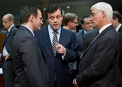 Brian Lenihan, Ireland's finance minister, center, speaks with George Papaconstantinou, Greece's finance minister, left, and Allistar Darlling, the UK's chancellor of the exchequer, right,  during the emergency meeting of European Union finance ministers in Brussels, Belgium, on Sunday, May 9, 2010. (Photo © Jock Fistick)