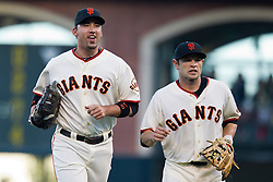 July 27, 2010; San Francisco, CA, USA;  San Francisco Giants first baseman Travis Ishikawa (left) and second baseman Freddy Sanchez (21) return to the dugout during the first inning against the Florida Marlins at AT&T Park. San Francisco defeated Florida 6-4.