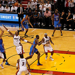 Jun 19, 2012; Miami, FL, USA; Oklahoma City Thunder point guard Russell Westbrook (0) shoots against Miami Heat power forward Chris Bosh (1) during the fourth quarter in game four in the 2012 NBA Finals at the American Airlines Arena. Miami won 104-98. Mandatory Credit: Derick E. Hingle-US PRESSWIRE