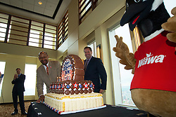 WaWa Welcome America announcement. Vista Top of the Tower, Philadelphia, PA USA - May 9, 2013; ..Philadelphia Mayor Michael Nutter, Chris Gheysens, WaWa President &amp; CEO and Wally Goose, WaWa's mascot cut a cake to celebrate the 20th Anniversary of the Welcome America event.<br />