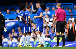 Gary Cahill of Chelsea passes the captains arm band to Cesar Azpilicueta of Chelsea after being sent off. - Mandatory by-line: Alex James/JMP - 12/08/2017 - FOOTBALL - Stamford Bridge - London, England - Chelsea v Burnley - Premier League