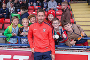 Jake Hyde with York City young fans during the Pre-Season Friendly match between York City and Newcastle United at Bootham Crescent, York, England on 29 July 2015. Photo by Simon Davies.