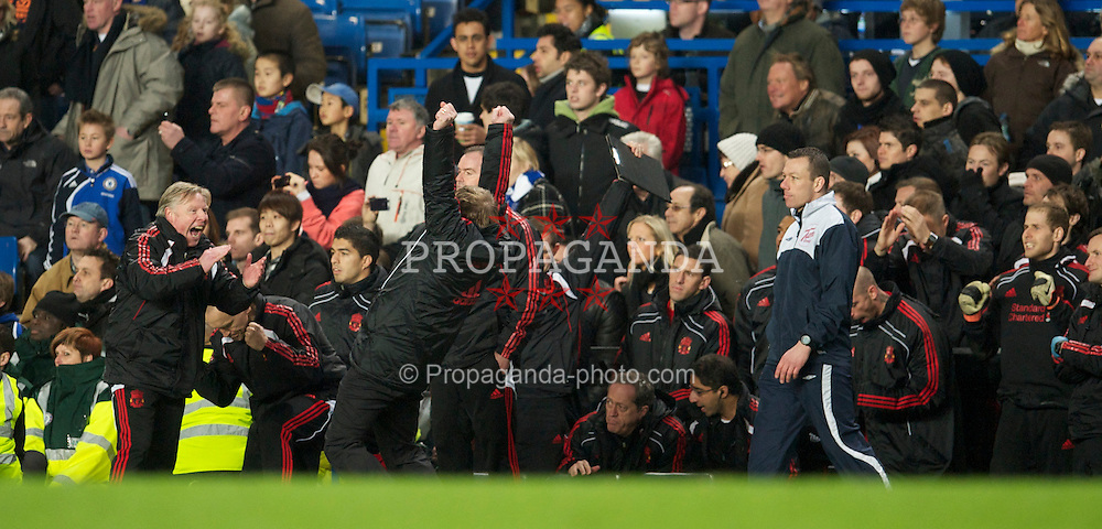 LONDON, ENGLAND - Sunday, February 6, 2011: Liverpool's manager Kenny Dalglish celebrates with assistant manager Sammy Lee after his side's 1-0 victory over Chelsea during the Premiership match at Stamford Bridge. (Photo by David Rawcliffe/Propaganda)