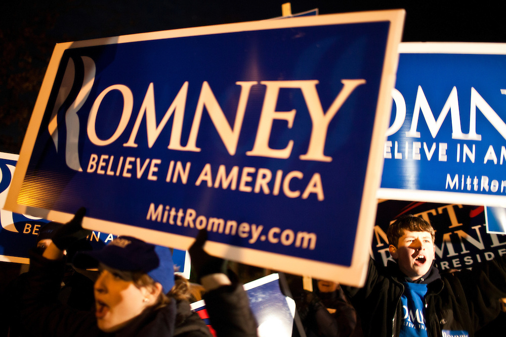 Supporters of Republican presidential candidate Mitt Romney rally outside the site of the WMUR/ABC News Debate at Saint Anselm College on Saturday, January 7, 2012 in Manchester, NH. Brendan Hoffman for the New York Times