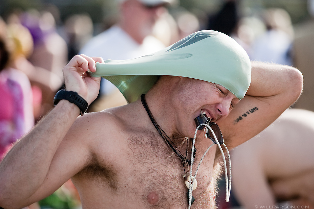 Robe Whittemor dons a swimming cap before the Polar Plunge at La Jolla Shores on New Year's Day.