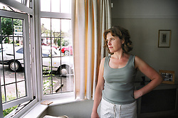 Woman gazing wistfully out of window