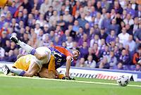 Rangers 3 v Motherwell 0, Scottish Premier League<br /><br />Flo beats Corrigan to the ball as he scores Ranger's opening goal