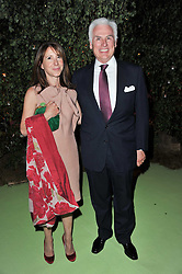 MR  JOHN & the HON.MRS DANILOVICH at a dinner hosted by Cartier in celebration of the Chelsea Flower Show held at Battersea Power Station, 188 Kirtling Street, London SW8 on 23rd May 2011.