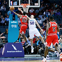 03 November 2015: Chicago Bulls guard E'Twaun Moore (55) goes for the layup past Charlotte Hornets forward Tyler Hansbrough (50) during the Charlotte Hornets  130-105 victory over the Chicago Bulls, at the Time Warner Cable Arena, in Charlotte, North Carolina, USA.