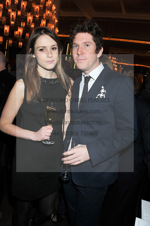 CHRISTOPHER TAYLOR and CAROLINE LEVER at a dinner hosted by Pablo Ganguli and Ella Krasner to celebrate the 10th Anniversary of Liberatum and in honour of Sir Peter Blake held at The Corinthia Hotel, Nortumberland Avenue, London on 23rd November 2011.