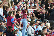 A young girl shows her support for Aston Villa during the Premier League match between Aston Villa and Everton at Villa Park, Birmingham, England on 23 August 2019.