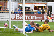 James Constable of Eastleigh (left) scores their first goal to make it Southport 0 Eastleigh 1 during the The FA Cup match at Haig Avenue, Southport<br /> Picture by Ian Wadkins/Focus Images Ltd +44 7877 568959<br /> 07/12/2014