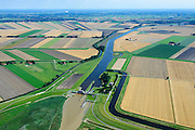 Nederland, Groningen, Oldambt,  05-08-2014; Nieuwe Statenzijl, gelegen op de grens met de Reiderwolderpolder. Sluizencomplex met spuisluis en schutsluis. Via de Westerwoldse Aa kan water op de Dollard geloosd worden<br /> Watermanagement complex with locks and sluice on the border with Germany. Used for discharging water into the Dollard<br /> <br /> luchtfoto (toeslag op standard tarieven);<br /> aerial photo (additional fee required);<br /> copyright foto/photo Siebe Swart