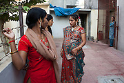 Bharti Utrekar (center), who is pregnant with twins for an American client, chats with other surrogates after her baby shower, organised on the 7th month of pregnancy, in the surrogate's house in Anand, Gujarat, India on 11th December 2012. Photo by Suzanne Lee / Marie-Claire France
