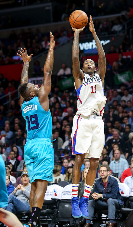 Los Angeles Clippers Jamal Crawford shoots against Charlotte Hornets PJ Hairston during the NBA basketball game in Los Angeles, the United States, Jan. 9, 2016. Los Angeles Clippers won 97-83. (Xinhua/Zhao Hanrong)(Photo by Ringo Chiu/PHOTOFORMULA.com)<br /> <br /> Usage Notes: This content is intended for editorial use only. For other uses, additional clearances may be required.