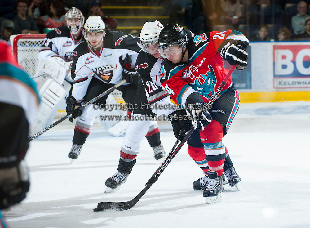 KELOWNA, CANADA - OCTOBER 3:  Tyson Baillie #24 of the Kelowna Rockets is checked by Tanner Moar #20 of the Vancouver Giants at the Kelowna Rockets on October 3, 2012 at Prospera Place in Kelowna, British Columbia, Canada (Photo by Marissa Baecker/Getty Images) *** Local Caption ***