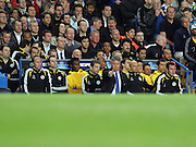 Chelsea manager Guus Hiddink gives instructions from the bench during the UEFA Champions League Semi Final Second Leg match between Chelsea and Barcelona at Stamford Bridge on May 6, 2009 in London, England.