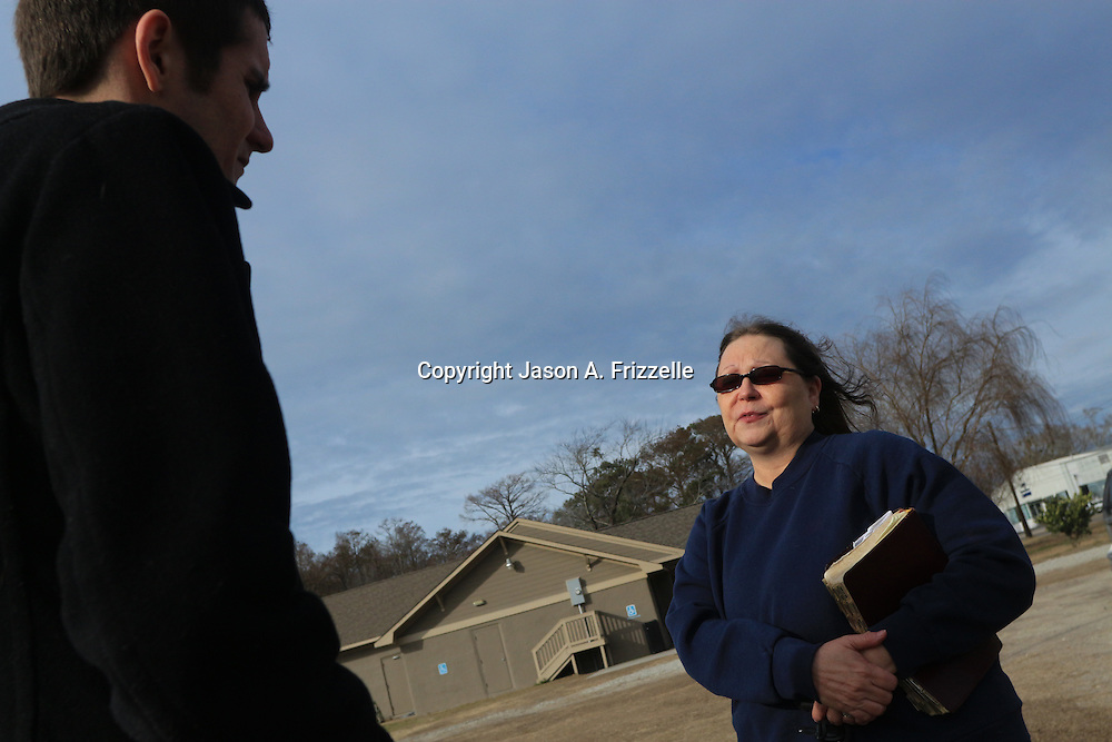 Patricia Rongotes, sister of Randy Hockabout speaks to Ryan Burris before a ceremony to remember her brother's life at Optimist Park, where his body was found on January 25, 1986. The homicide has remained unsolved and Hockabout's family have launched new efforts to solve the crime including using facebook to find leads. (Jason A. Frizzelle)